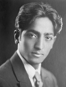 """J. Krishnamurti is one of the most influential speakers and spiritual teachers of the 20th century. Although he himself would never call himself a teacher - that would be against his whole teaching. He sounds more like a companion, that helps you to grow your own understanding in a friendly and respectful way. The very core of his teaching is the ultimate respect for one's individuality and freedom, so he is not giving you fixed ideas, but rather invites you to look at the subject, to see and understand for yourself. And the very understanding will bring the change. J. Krishnamurti was born in an orthodox brahmin family, his father was also a member of the Theosofical Society, an esoteric organization that was popular at the time in the western society. When he was 13, one of the leaders of the Society recognized him as a future World Teacher. The boy was taken away from his family and passed a complex process of education to prepare for his great future mission. A special Order is created to support the coming World Teacher, and Krishnamurti becomes its head. Initially the young man was convinced in his mission, however with time he started doubting the teachings of the Theosofical Society and rebelling against his strict mentors. In 1922 J. Krishnamurti moved to a cottage in California, which became his official residence for the rest of his life. Soon after arriving to California Krishnamurti went through a series of """"life-changing"""" spiritual experiences, which initiated """"a process"""", that continued on and off throughout his whole life. This experience Krishnamurti described as """"sacredness"""", """"benediction"""", """"immensity"""" or simply """"the other"""". After the experience Krishnamurti starts growing confidence, in his speeches he goes further ad further away from the teachings of Theosofical Society. In 1929 in front of thousands of members he dissolves the Order he was heading, marking the turning point in his life and teachings. He breaks up completely with the Theosophica"""